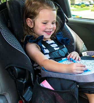 Girl Happily Playing With Travel Tray